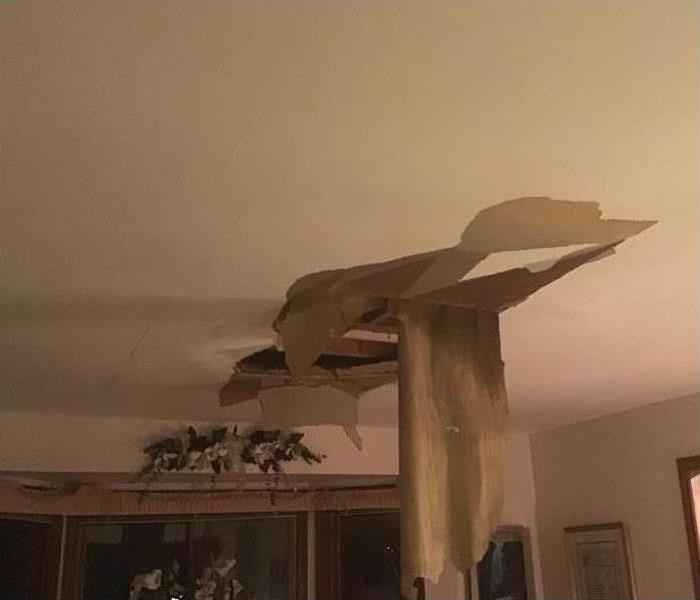 Roof leak with damage to the ceiling in living room