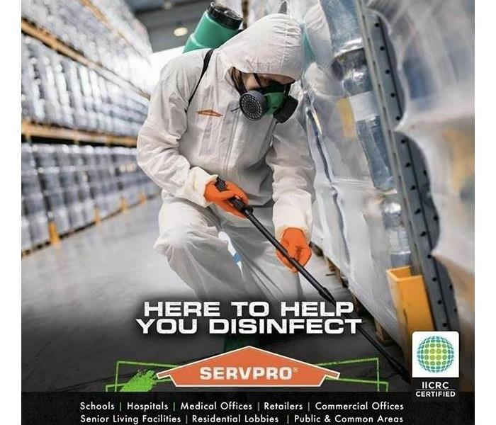 Servpro Technician Disinfecting Large Warehouse