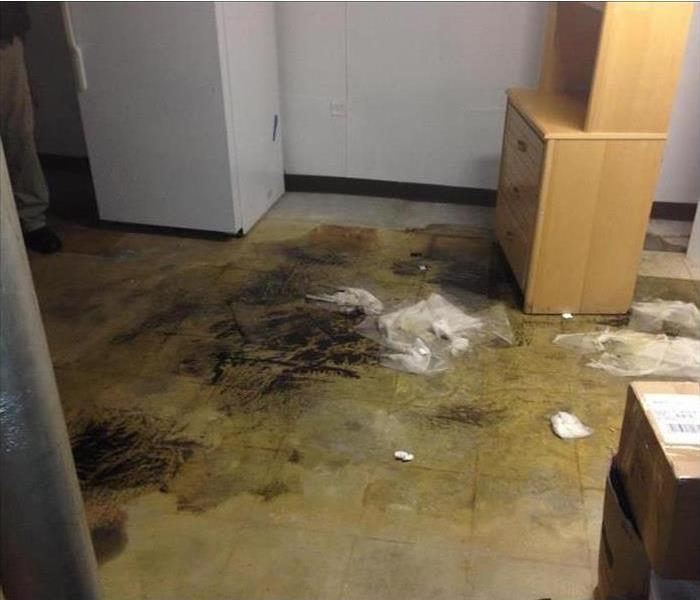 Sewage backup on the floor of a medical office